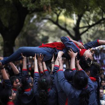 Volunteers perform a skit as women's groups gather near the Indian parliament to protest at a new sexual violence law they say is inadequate (AP)