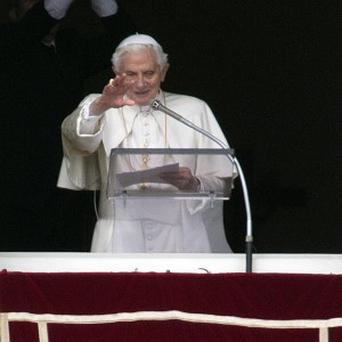 Pope Benedict XVI delivers his blessing during his last Angelus noon prayer (AP)