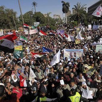 Thousands of protesters shout slogans supporting Islamist President Mohammed Morsi outside Cairo University in Cairo (AP/Amr Nabil)