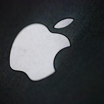 Apple has agreed to give more than 66 million pounds in iTunes store credits to settle a lawsuit in the United States.