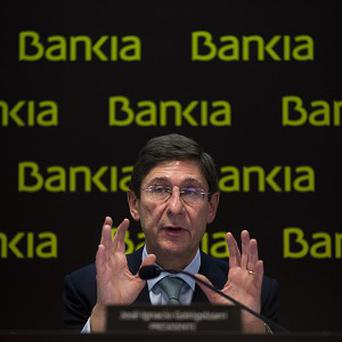 Bankia's President, Jose Ignacio Goirigolzarri speaks at a press conference on the bank's results in Madrid (AP)