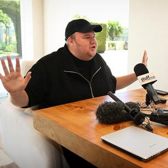 Megaupload founder Kim Dotcom says he cannot be held responsible for those who chose to use the site to illegally download songs or movies (AP)