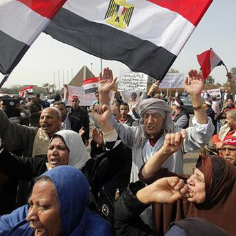 One protester has died and dozens have been wounded in violent anti-government clashes with police in the Nile Delta (AP)