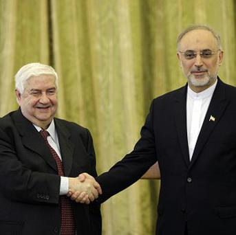 Syrian foreign minister Walid al-Moallem, left, and his Iranian counterpart Ali Akbar Salehi (AP)