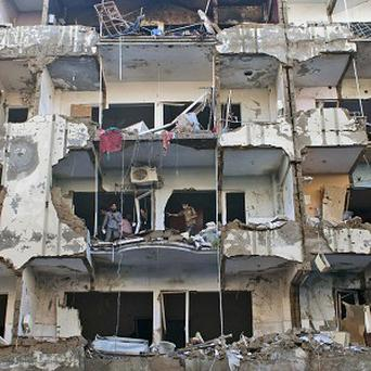 An apartment block devastated by the bombing (AP)