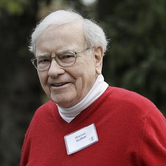 Billionaire Warren Buffett is sliding down the list of the world's richest people (AP)