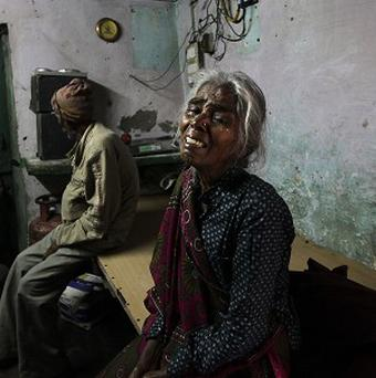 The mother of Ram Singh cries as she speaks to journalists inside the family's home in New Delhi (AP)
