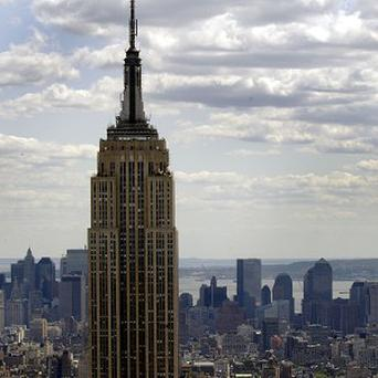 A woman holding a baby boy has fallen to her death from the eighth floor of a New York City apartment, but miraculously the baby survived