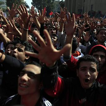 Egyptian fans of Al-Ahly club celebrate a court verdict that returned 21 death penalties over football riots last year which left 74 dead (AP)
