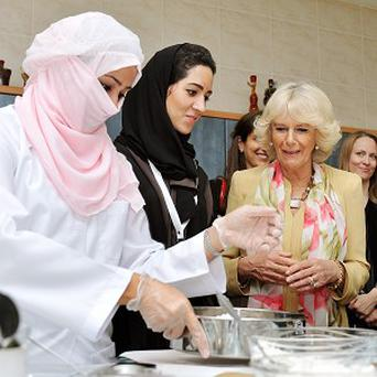 The Duchess of Cornwall meets women who are learning cooking skills at the Bab Rizq Jameel Nafisa Shams Female Academy for Arts and Crafts