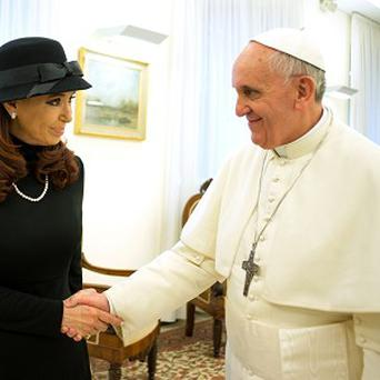 The pope and Mrs Kirchner shake hands at the Vatican (AP)