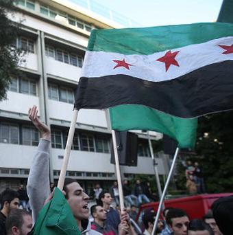 Syrian rebels deny carrying out a chemical weapon attack (AP