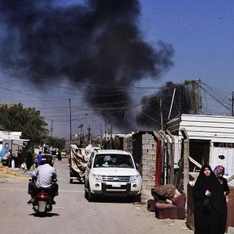 A car bomb attack hits Sadr City, Baghdad, amid a wave of blasts that killed dozens of people on the 10th anniversary of the start of the Iraq war (AP)