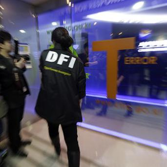 A police officer from Digital Forensic Investigation enters the Cyber Terror Response Centre in Seoul, South Korea (AP/Lee Jin-man)