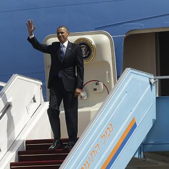 President Obama waves as he steps off Air Force One