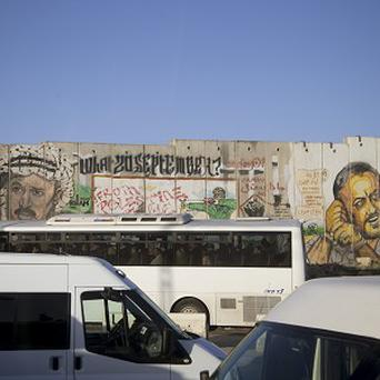 Traffic is at a standstill near a section of Israel's separation barrier near a crossing checkpoint (AP)