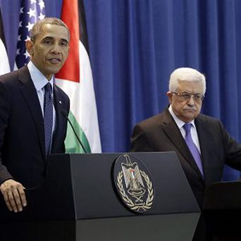 US President Barack Obama and Palestinian President Mahmoud Abbas during their joint news conference in Ramallah (AP)
