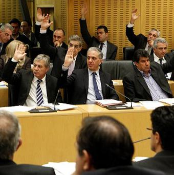 Cyprus politicians vote on key bills aimed at securing a broader bailout package (AP/Petros Karadjias)