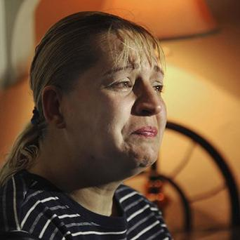 Sherry West breaks down in tears as she describes the incident where her baby son was fatally shot and she was wounded (AP/The Brunswick News, Bobby Haven)