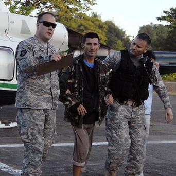 Australian hostage Warren Rodwell, centre, arrives at the Command's headquarters in Zamboanga city in southern Philippines (AP/AFP-WESTMINCOM)