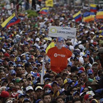 Supporters of Venezuela's opposition presidential candidate Henrique Capriles attend a campaign rally in Carora (AP)
