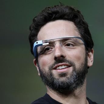 Google co-founder Sergey Brin demonstrates Google's new Glass, wearable internet glasses, at the Google I/O conference in San Francisco (AP)
