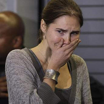Amanda Knox said she is 'ready to fight' after a retrial was ordered in the case of British student Meredith Kercher's murder (AP)