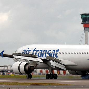 An unruly passenger has had to be restrained on an Air Transat flight
