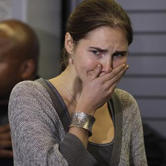 Amanda Knox faces a new trial over the murder of Meredith Kercher (AP)