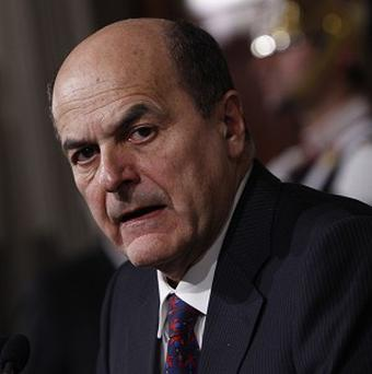 Democratic Party leader Pier Luigi Bersani speaks to journalists after meeting with Italian President Giorgio Napolitano (AP)