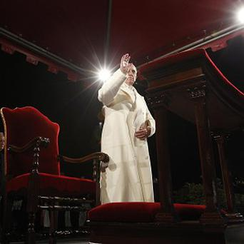 Pope Francis waves at the end of the Via Crucis (Way of the Cross) torchlight procession celebrated in front of the Colosseum (AP)