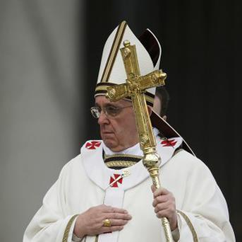 Pope Francis arrives in St Peter's Square for the Easter Mass (AP)