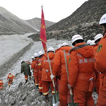 Rescue workers seek survivors after a mudslide in Gyama village, in Maizhokunggar County of Lhasa, Tibet (AP)