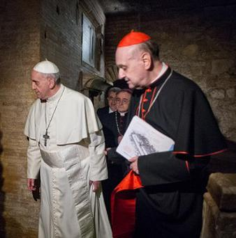 Pope Francis visits the necropolis where pagans and early Christians were buried, under St Peter's Basilica at the Vatican (AP/L'Osservatore Romano)