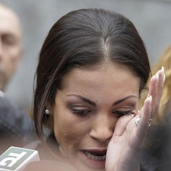 Karima el-Mahroug, the Moroccan woman at the centre of ex-Premier Silvio Berlusconi's sex-for-hire trial, wipes away a tear as she accuses prosecutors of waging psychological warfare against her (AP)