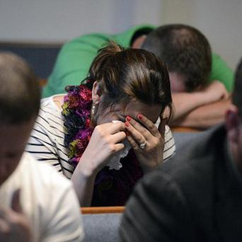 Members of the Adventure in Faith Church pray for the family of two young children who died in the collapse (AP/The Charlotte Observer, Jeff Willhelm)