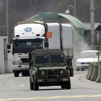South Korean vehicles returning home from North Korea's Kaesong factory are escorted by the South Korean military (AP)