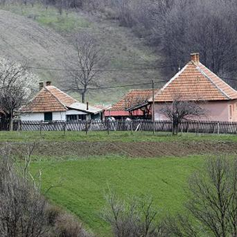 Serbian police in the village of Velika Ivanca, where a man killed 13 people, including a baby (AP)
