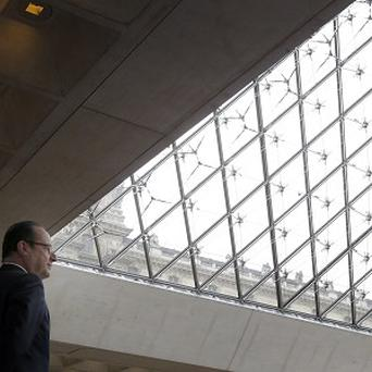 French president Francois Hollande at the Louvre before it closed (AP)