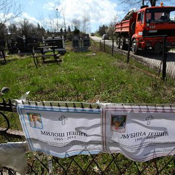 Death notices of Milos and Ljubina Jesic, victims of a shooting that left 13 people dead in the Serbian village of Velika Ivanca (AP)