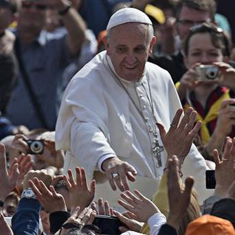 Officials have confirmed that Pope Francis has decided Vatican employees will not be getting the bonus that traditionally comes with the election of a new pontiff (AP)