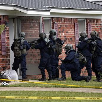 Armed federal agents at the home of Paul Kevin Curtis in Corinth, Tennessee (AP)