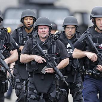 A SWAT team patrols in Watertown, Boston (AP)