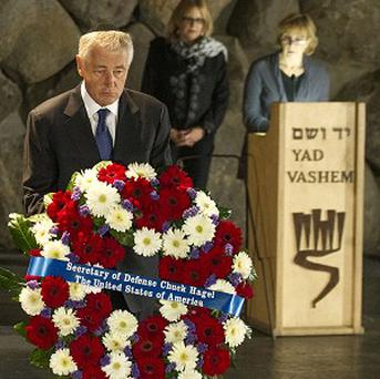 US defence secretary Chuck Hagel places a wreath at the Hall of Remembrance as he tours Yad Vashem in Jerusalem (AP)