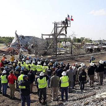 Workers pause for a memorial service at the site of the fire and explosion in West, Texas (AP/The San Antonio Express-News, Tom Reel)