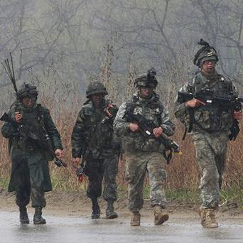 US and South Korean army soldiers march in the rain during their military exercise in Paju near the border with North Korea (AP)