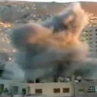 A video image shows an explosion during heavy fighting between rebels and Syrian government forces in the Barzeh district of Damascus (AP)