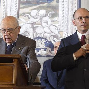 Italian premier-designate Enrico Letta, right, and president Giorgio Napolitano address the media (AP Photo/Domenico Stinellis)