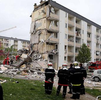 Firemen attend the scene of an explosion in Reims, eastern France (AP)