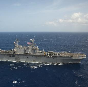 US Navy warship the USS Peleliu was diverted to help with the search for a missing British sailor (AP Photo/US Navy)